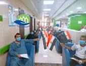 صور.. مستشفى إسنا للحجر الصحى تعلن خروج 31 حالة شفاء من فيروس كورونا