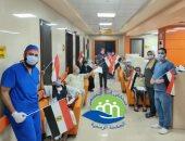 صور.. تعافى 22 شخصا من فيروس كورونا وخروجهم من مستشفى إسنا للحجر الصحى