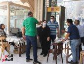 كنائس القاهرة تستقبل القداسات بأجهزة قياس حرارة وكحول وكمامات