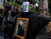 مظاهرات فى تايلاند تطالب باستقالة رئيس الوزراء باستخدام صور وأقنعة هارى بوتر