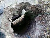 عجوز أوكرانية تحفر نفقا طوله 35 قدما بمفردها تحت أسوار السجن لتهريب ابنها ..صور