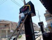 حملة لإزالة الإعلانات غير المرخصة والعشوائية بمركز الباجور في المنوفية.. صور