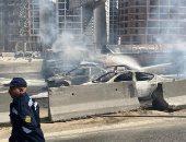 صور.. عمليات تبريد موقع حريق دائرى المعادى ورفع السيارات المتفحمة