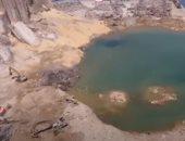 لقطات جوية تظهر حفرة بعمق 43 مترا تسبب فيها انفجار مرفأ بيروت.. فيديو
