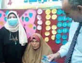 صور.. محافظ الشرقية يرسل رئيس مدينة ههيا لنقل مريضة للتصويت فى الانتخابات
