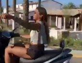 دينا الشربيني فى أحدث ظهور لها من الساحل الشمالى على سكوتر.. فيديو وصور