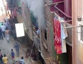 قارئة تشارك بصور حريق اندلع بعقار فى شارع القومية بمنطقة إمبابة بالجيزة