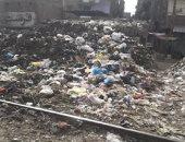 قارئ يشكو تراكم القمامة وسد فتحات المرور بنفق مدينة المحلة فى الغربية