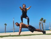 محمد الشرنوبي يقضي عطلته الصيفية في تمارين رياضية قاسية بصحبة زوجته