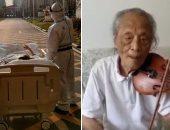 الصينى صاحب صورة الشمس الشهيرة ينجو من كورونا ويعزف الكمان للأطباء.. اعرف القصة