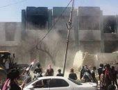 متظاهرون عراقيون يهدمون مقار حزبية بالجرافات فى محافظة ذى قار.. فيديو