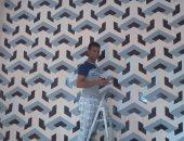 """إبراهيم فنان قناوى.. من قسم الميكانيكا للرسم على الحوائط والنقاشة """"صور"""""""
