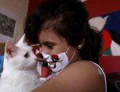 باستخدام الألوان وقطتها ..طفله فلسطينية ترسم على الوجه إجراءات الحماية من كورونا..ألبوم صور