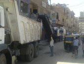 حملات نظافة لشوارع وميادين القوصية وتهذيب الأشجار بأسيوط