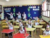 المدارس الدولية الحكومية تطبق اجراءات مواجهة كورونا فى أول يوم دراسة.. صور