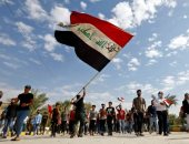 أمن العراق يطلق مدافع المياه والغاز المسيل للدموع على محتجين فى بغداد.. صور