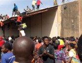 نهب أدوية للموجة الثانية من كوفيد - 19 من مستودع حكومى بنيجيريا.. صور