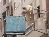 حملة لصيانة وإصلاح أعمدة الإنارة بشوارع المحلة