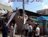 صور.. حملة لإزالة بنرات مرشحى النواب ورفع إشغالات المحلات بالمحلة