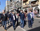 محافظ بورسعيد يطالب أصحاب المحال بالالتزام بالمساحات المقررة ورفع الإشغالات