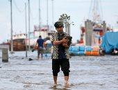 موجة جديدة من الفيضانات تضرب أندونيسيا ودول شرق آسيا.. ألبوم صور