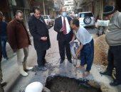 إصلاح هبوط أرضى بشارع زاخر فى شرق الإسكندرية