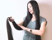 يابانية لم تقص شعرها 15 عاما ليصل إلى متر و82 سم.. صور