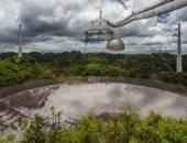 شاهد عملية تفكيك تلسكوب أريسيبو المنهار من الفضاء.. صور