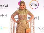 يسرا ترتدي شنطة محفور اسمها عليها في ختام مهرجان القاهرة