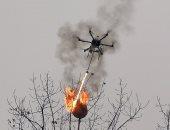 """تحويل طائرة """"درون"""" إلى قاذفة لهب للهجوم على أعشاش الدبابير بالصين.. فيديو وصور"""