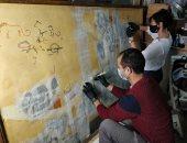 ترميم رسم جدارى خاص بالمقبرة رقم 100 بمنطقة الكوم الأحمر