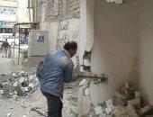 إزالة حوائط تتعدى على المنفعة العامة بحى العجمى غرب الإسكندرية.. صور