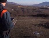 """عسكريون روس يزيلون الألغام باستخدام """"الدرون"""" من بقايا حرب قره باغ.. فيديو"""
