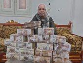 أغرب تبرع.. شقيق برلمانى يثير الجدل بصورته مع مليون جنيه