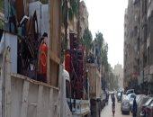 رفع إشغالات بشوارع الجيزة خلال حملات على الأحياء.. صور