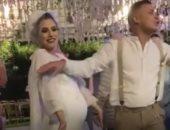 """صاحب صورة """"العروس الحامل"""": تزوجنا منذ عامين والحفل للإعلان عن نوع المولود"""
