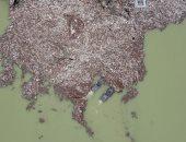 ذاب الجليد وظهرت القمامة.. اختفاء بحيرة فى صربيا تحت جبل من المخلفات.. ألبوم صور