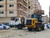 رفع وإزالة تجمعات القمامة والمخلفات بمنطقة أبراج بورتكس ببورسعيد