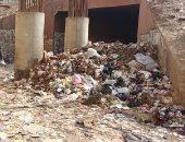أهالى: القمامة تنتشر بالمناطق الشعبية فى الجيزة والمحافظ لم يتحرك.. صور