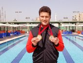 """""""جودة"""" بورسعيدى هزم الإعاقة وحصل على الميدالية الفضية فى السباحة بأستراليا.. صور"""
