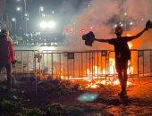 صور.. اشتباكات بين الشرطة التايلاندية ومحتجين بمحيط قصر الملك