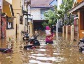 فيضان إندونيسيا يضر بالبشر والشجر ويحصد 157 قتيلا.. ألبوم صور