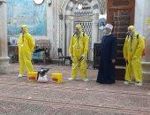 تعقيم مسجد السيدة عائشة استعدادا لشهر رمضان.. فيديو وصور
