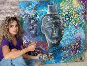 تحول الفن من المنزل للشارع.. رسامة سورية تنقل لوحاتها الفنية على الملابس (صور)