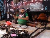 رجال أمام النار في رمضان..فران السمك إحدى المهن الشاقة في بورسعيد (لايف وصور)