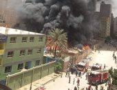 بدء عمليات تبريد وتتبع الأدخنة بحريق مخزن حى الهرم للسيطرة عليه بالكامل.. صور