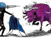 """كاريكاتير اليوم.. الحرب على كورونا أشبه بـ""""مصارعة الثيران"""""""