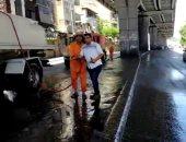شاهد فرق النظافة بمحافظة القاهرة تغسل الشوارع والأرصفة ثان أيام العيد
