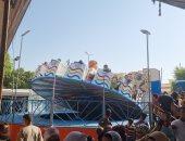 إقبال المواطنين على الملاهى والألعاب فى ثان أيام العيد بسوهاج.. فيديو وصور
