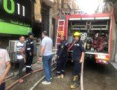 السيطرة على حريق عقار من 3 طوابق فى الدقى.. صور